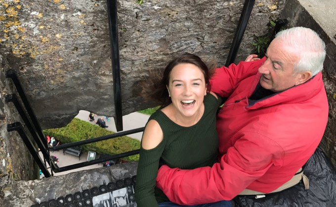 Kissing the Blarney Stone at Blarney Castle in County Cork, Ireland