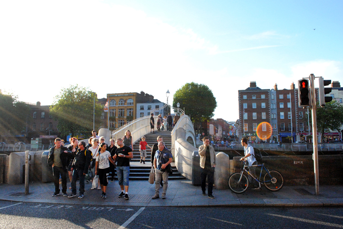 People waiting near the Ha'Penny Bridge in downtown Dublin, Ireland