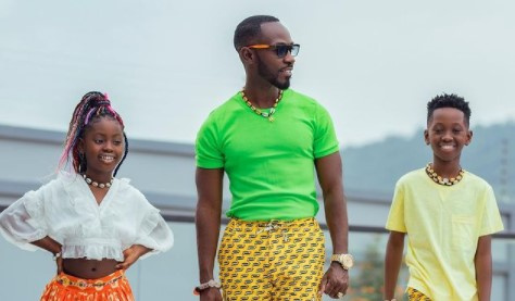 Okyeame Kwame poses with his kids