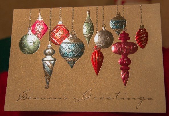 Christmas card with glowing ornaments