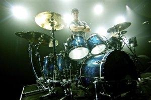 Drummer Van Romaine at his kit