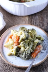 Creamy vegetable bake packed with carrots, broccoli, cauliflower, and lots of cheese!