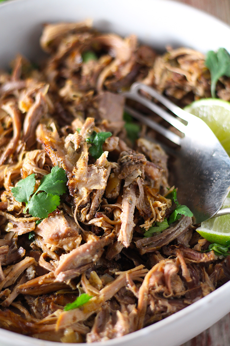Incredibly tender Mexican slow cooker smoky pork carnitas are super easy to make and full of flavor. The meat is so juicy on the inside and perfectly crisp on the outside with two ways to achieve the perfect golden finish.