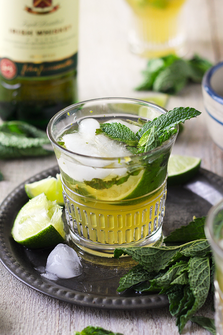 Mint and lime muddle together and mix with Irish whiskey and ginger beer to create a tasty and refreshing drink for St. Patrick's Day or any day! This naturally green cocktail is perfect for festivities.