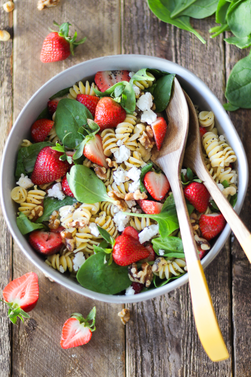 Summer pasta salad that's perfect for BBQs and parties! This flavor-packed strawberry and goat cheese pasta salad is the perfect combination of pasta, fresh strawberries, baby spinach, tangy goat cheese (or feta), walnuts and homemade lemon poppy seed dressing. It's a definite crowd pleaser!