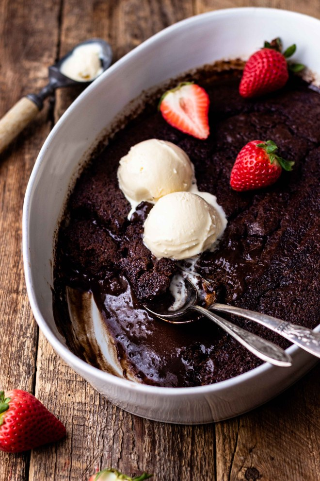 Super easy, self-saucing chocolate pudding cake! The perfect amount of sweetness. While baking, this dessert separates into a layer of delicious chocolate cake over the top of rich, hot fudge pudding. This pudding cake is sure to impress! Serve with vanilla ice cream for the best chocolate dessert!