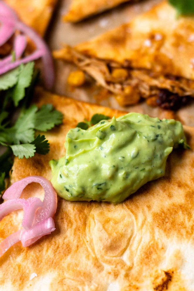 Easy to make and insanely flavorful chipotle chicken, sweet corn, and cheddar cheese tucked between two flour tortillas and grilled to golden, melty perfection. Top with the most delicious, creamy Avocado Lime Crema and lots of fresh garnishes!