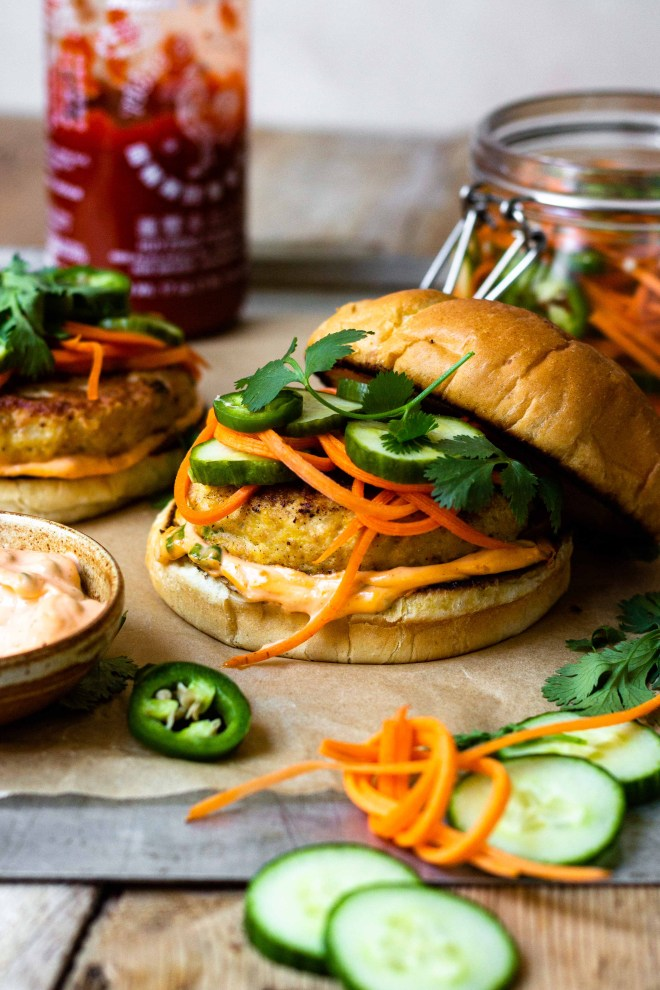 Crave worthy Chicken Banh Mi Burgers that are made with juicy, tender, perfectly seasoned ground chicken and sandwiched between toasted buns then spread with spicy sriracha mayo and topped with crunchy, tangy, quick pickled cucumber, carrot and jalapeño. Finish with fresh cilantro, if desired. The perfect combination!