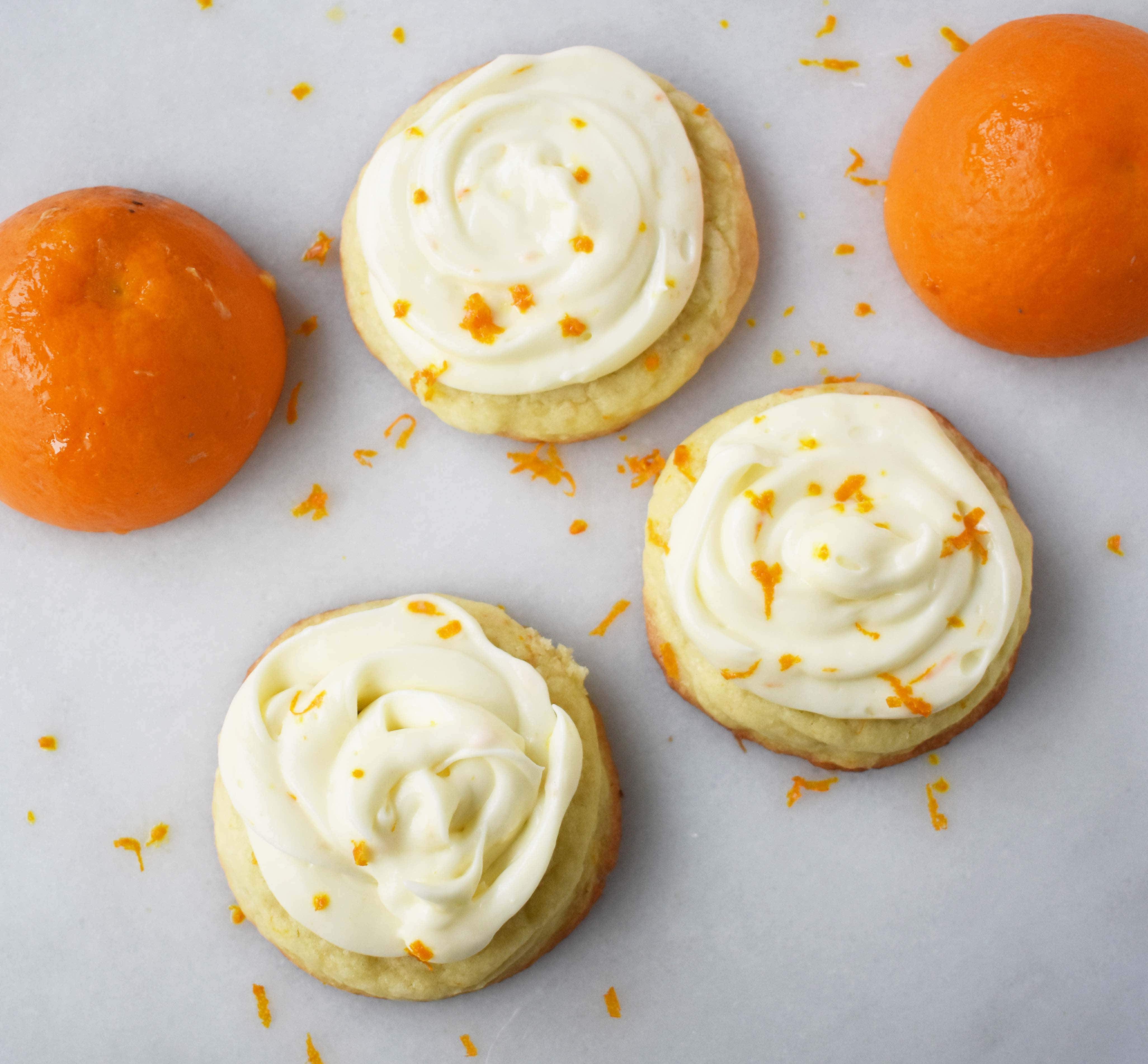 RubySnap Judy Orange Cream Cookies. Soft citrus orange dough cookie topped with sweet orange cream cheese frosting. An orange cream lovers dream cookie! www.modernhoney.com