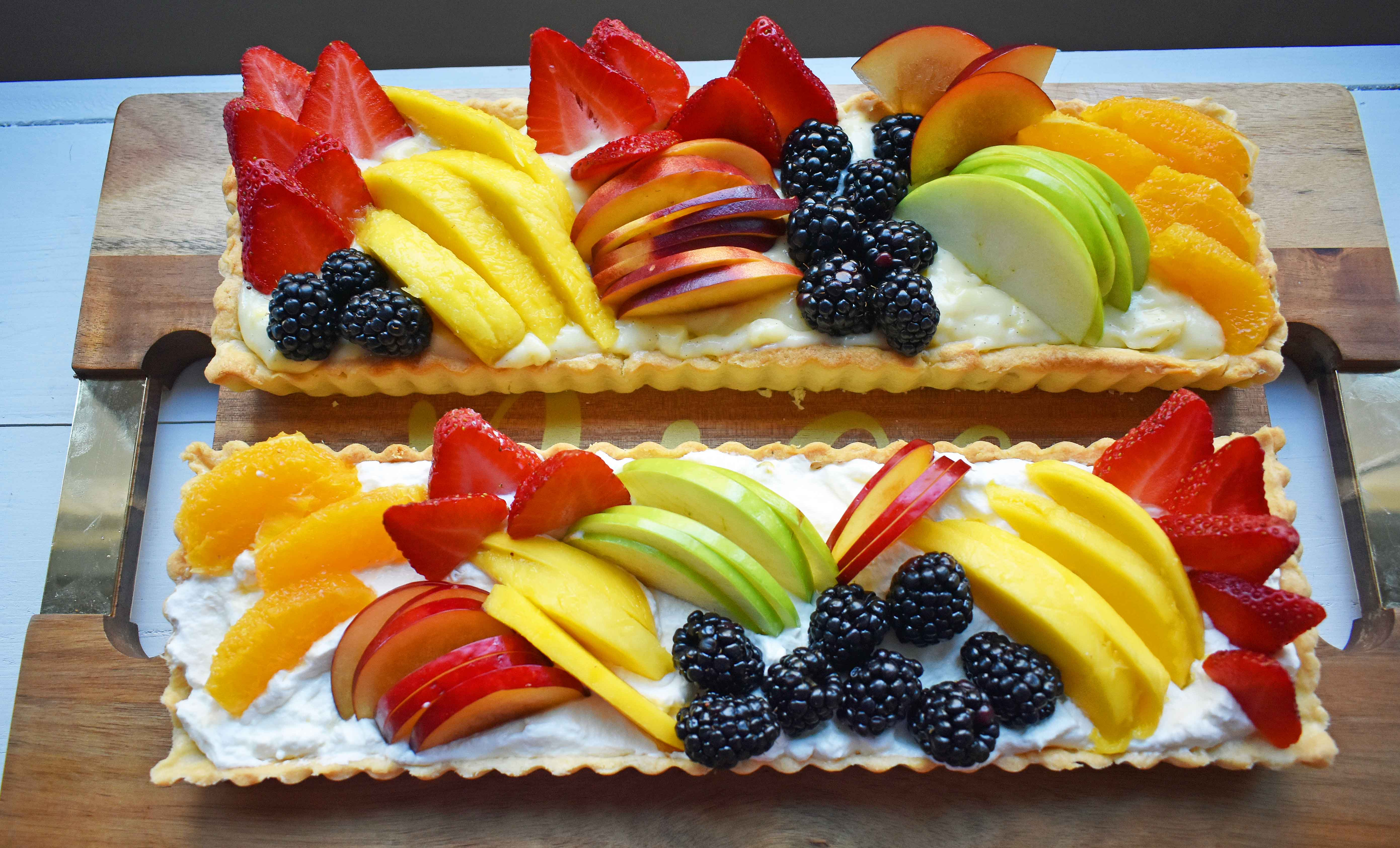 Lemon Cream Filled Fruit Tart. Buttery, flaky pie crust baked in tart pan and filled with homemade lemon cream and topped with sliced fresh fruit. A beautiful Spring and Summer dessert that everyone loves. www.modernhoney.com