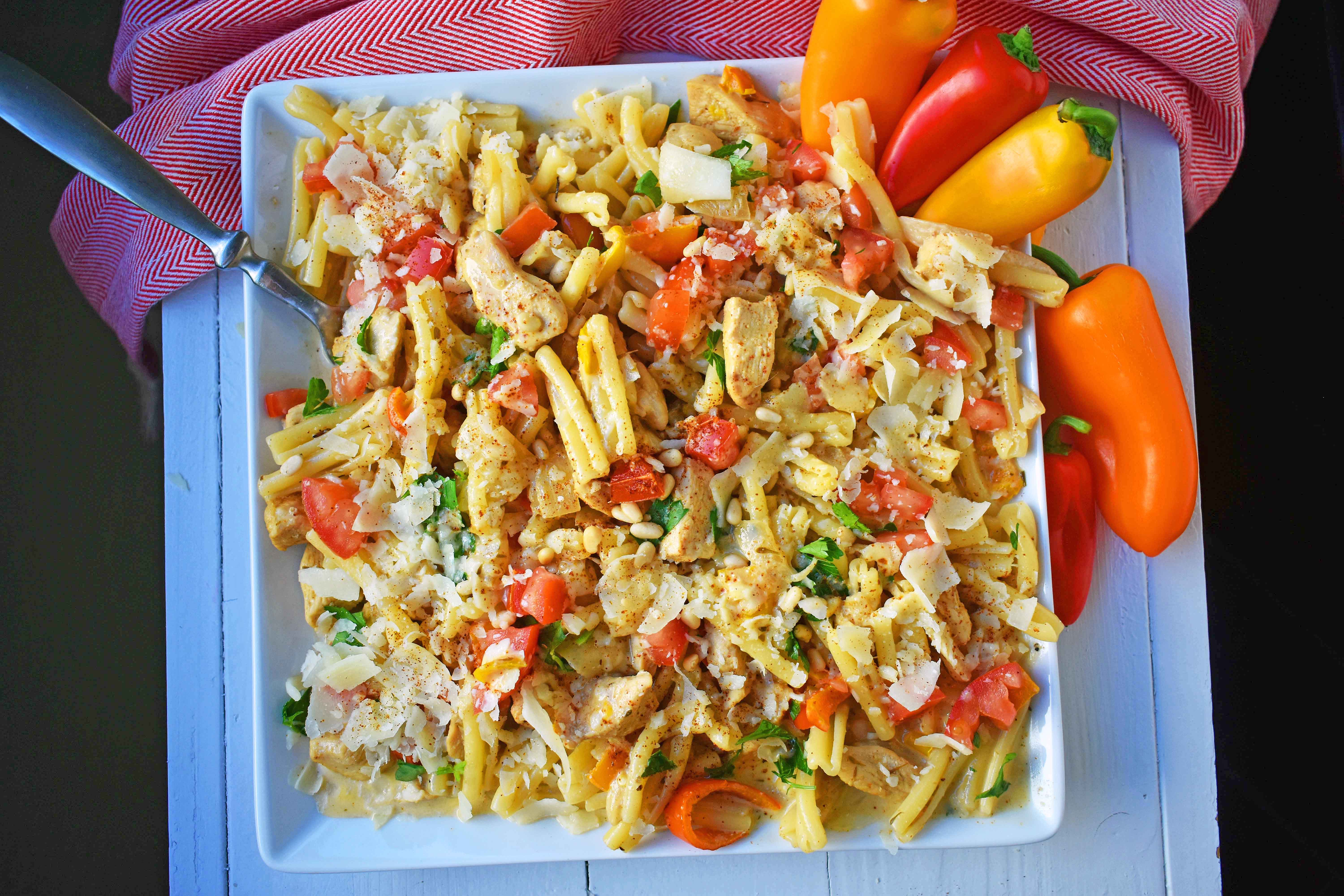 Cajun Louisiana Chicken Pasta made with onions, peppers, chicken, and cajun cream tossed with your favorite kind of pasta and topped with parmesan cheese and pine nuts. A super flavorful creamy pasta dish. www.modernhoney.com