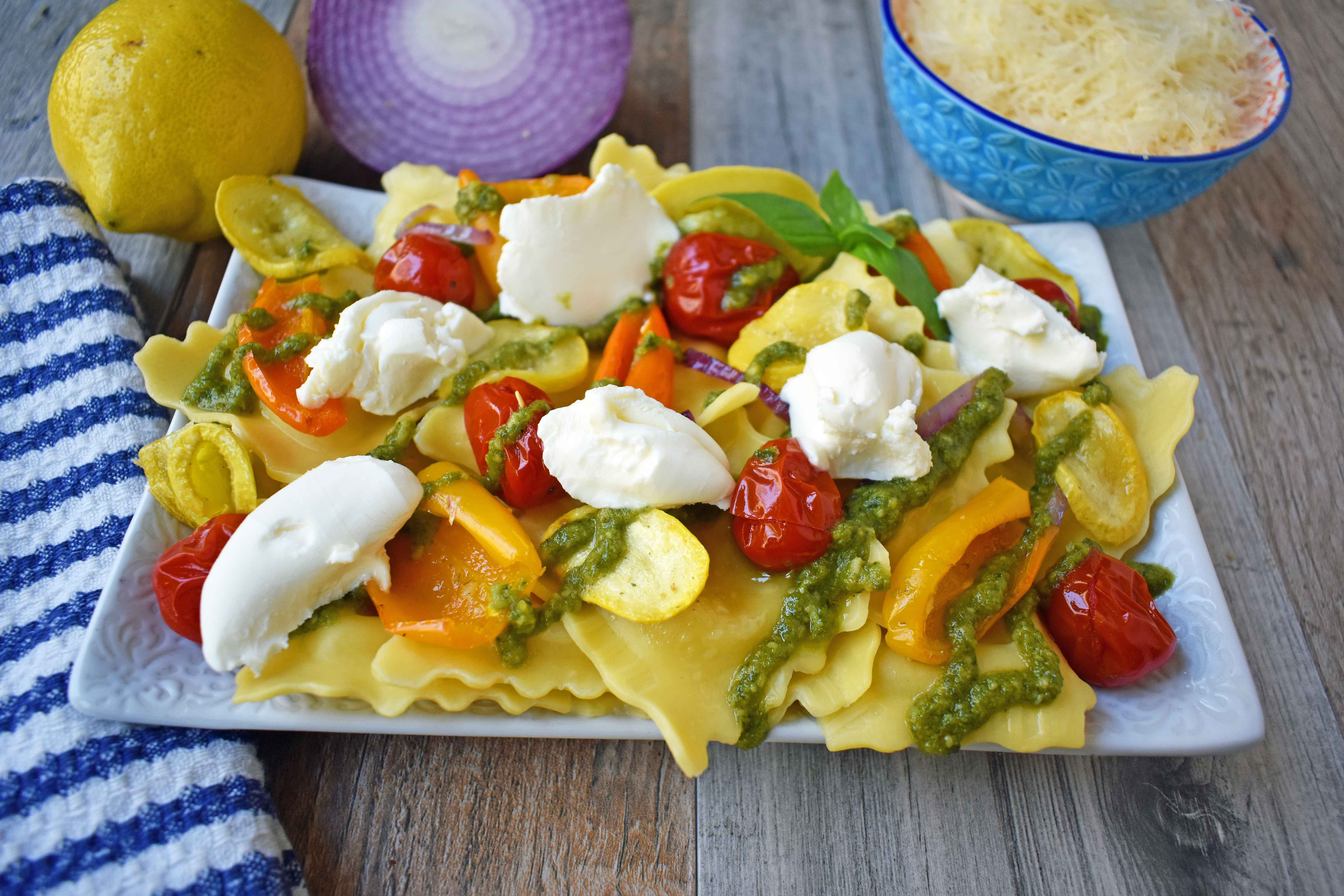 Summer Roasted Vegetable Pesto Ravioli by Modern Honey. This light and fresh summer pasta dish is made with fresh ravioli, tender roasted vegetables, basil pesto sauce, and a touch of mascarpone cheese. A vibrant and healthy pasta dish. www.modernhoney.com