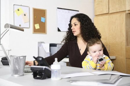 Woman Working with Baby