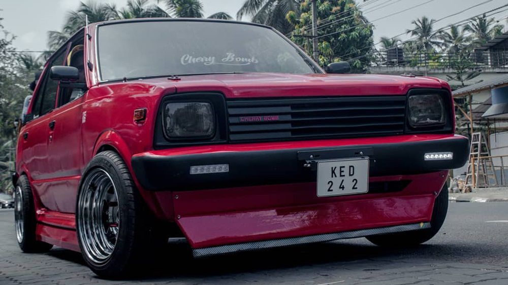 Modified 1986 Maruti 800 draped in Cherry Red