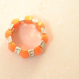 Bransoletka pomarańczowa z cekinami
