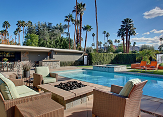 Firepit by the pool at a Moderne Vacations rental property