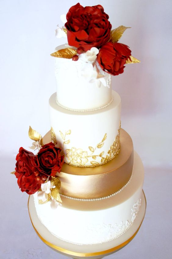 Red Flower Topped Gold and White Wedding Cake   MODwedding More on Cakes   Desserts