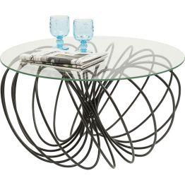Couchtisch: Feines Linienspiel Der Tisch wirkt wie skizziert und zelebriert die Eleganz des Minimalistischen. Auf einem fein gezeichneten runden Gestell mit schlanken Metallstäben ruht eine Tischplatte aus Sicherheitsglas. Eine moderne und raffiniert gestaltete Komposition