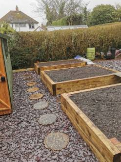Raised Bed Planter With Railway Sleepers and Stepping Stones