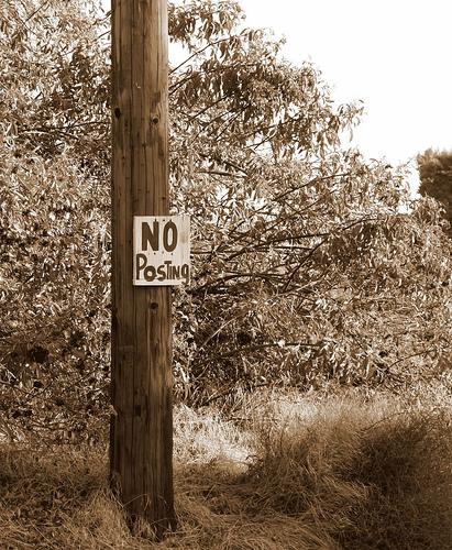No posting poster nailed to pole