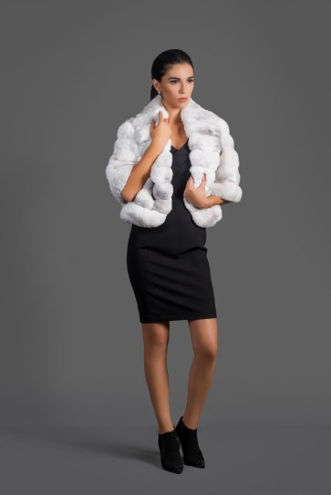 Jacket, white chinchilla (natural color), Malimo; booties, Baldinini; dress, Marc Cain; earrings, stylist's own.