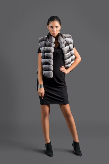 Jacket, chinchilla (natural color), Malimo; dress, Marc Cain; booties, Baldinini; earrings, bracelet, all - stylist's own.