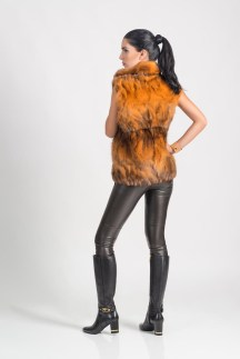 Orange sable vest (dyed color), Malimo; trousers, Marc Cain; booties, Baldinini.