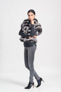 Jacket, chinchilla (natural color), Malimo; jeans, pullover, all - Marc Cain; booties, Baldinini; earrings, stylist's own.