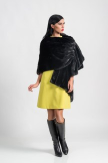 Black mink cape (natural color), Malimo; dress, Marc Cain, boots, Baldinini.