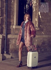 Faux fur coat, shirt, all - Mango; knitted dress, Miu Miu, KUL-T boutique; bag, Valentino, Four Seasons boutique; ankle boots, Pollini, Timinis boutique; suitcase, BG Berlin.