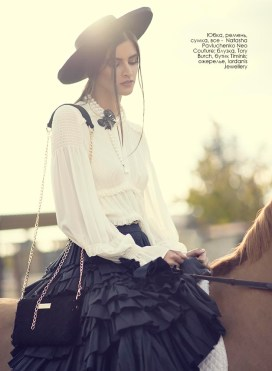 Skirt, belt, bag, all - Natasha Pavluchenko Neo Couture; blouse, Tory Burch, Timinis boutique; necklace, Iordanis Jewellery