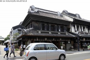 "Kurazukuri Street: The word ""kura"" means ""warehouse."" The kurazukuri are clay-walled warehouse-styled buildings that are constructed with an Edo architectural flavor."
