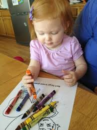 set of crayons and color books