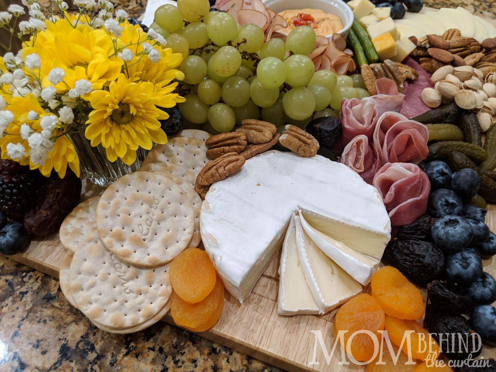 Charcuterie cheese and meat board, food idea for book club meeting of Bad Blood, about Elizabeth Holmes and Theranos.