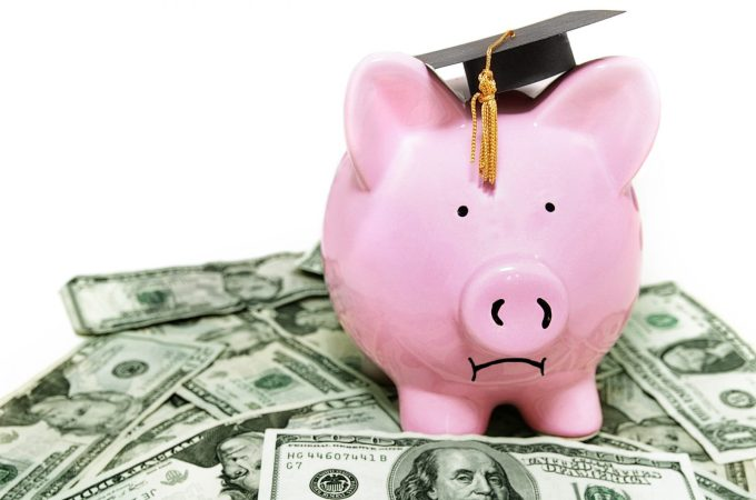 illustration of the high cost of college - piggy bank with graduation cap