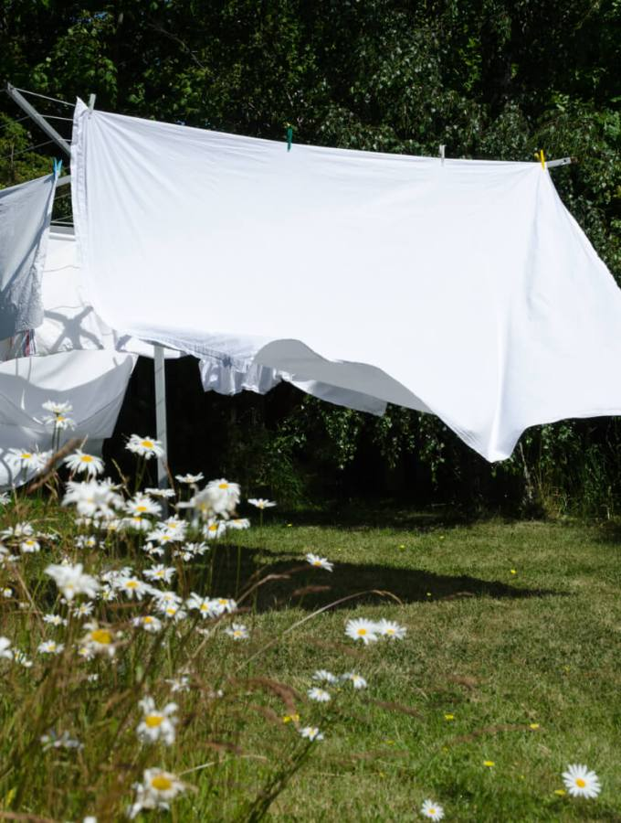 Why do sheets not fit mattresses anymore? Sheets that fit won't save the world but would save frustration! Thick mattresses, platforms & pockets explained. - Sheets drying on an outside clothes line.