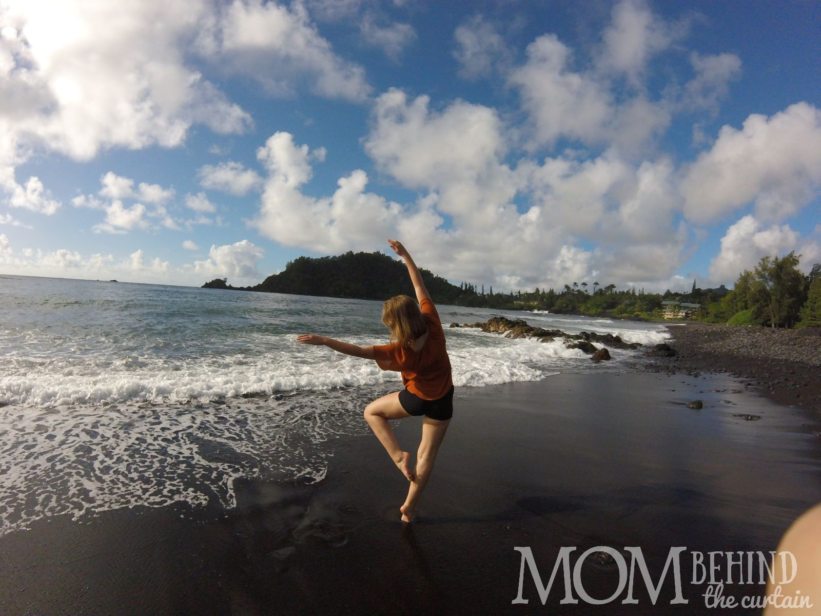 In Hawaii with teens? There's going to be lots of photos taken on the beach, like this photo of my teen girl posing on a black beach on Maui.Hawaii with teens, 8 tips for the best trip - Hawaii is one of the best places to vacation with teens. Our family vacation to Maui was one of the best we've ever had. Read on for tips about where to stay, what to do, and how to plan the best vacation ever to make memories in Hawaii with teens!