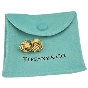 Mother's Day Gifts that Won't Break the Bank -Tiffany Twist Earrings gold on blue gift bag as example of what is NOT a good example