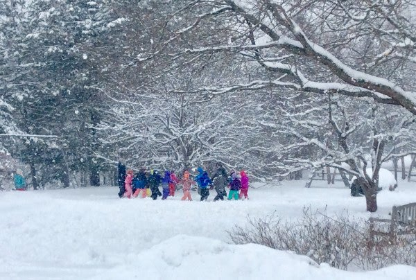 Kids Playing Outdoors in the Snow at School