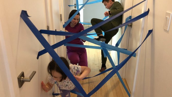 laser maze made of blue painters tape as an indoor snow day activity for kids