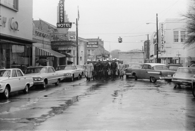 A Riot squad marches down Pine Street to the Hattiesburg courthouse 0n January 22, 1964.