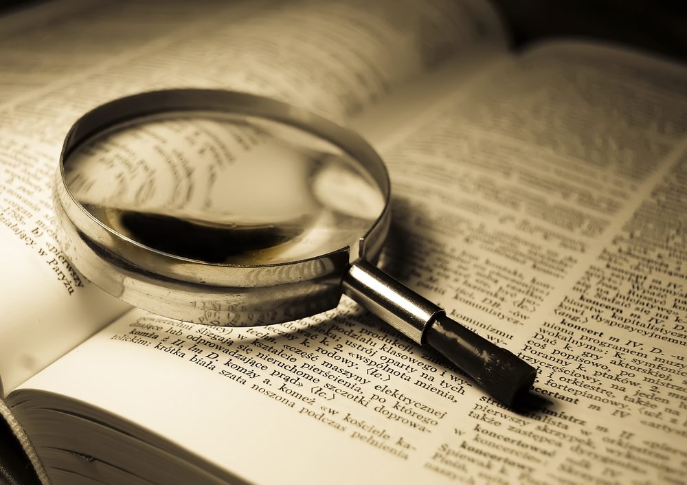 Magnifying Glass on Dictionary