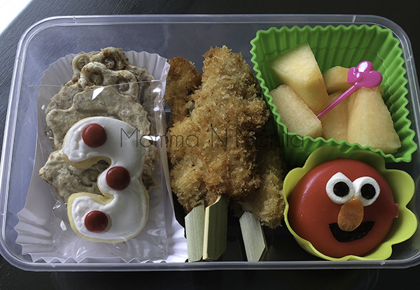 I packed a bento of everything I knew the kids could eat with their hands. Chicken Fingers, melon, whole wheat sammies with Goober Peanut Butter and Chocolate and a Baby Bel Cheese disc.