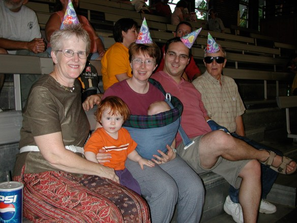 The year with party hats and cake. Dad had just had cataract surgery, hence the fashion shades.