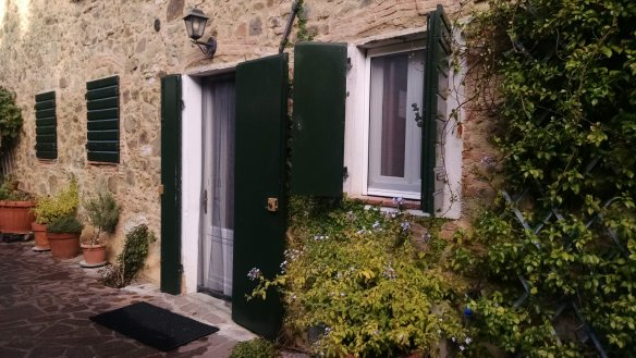 The outside shutters on the lower doors and windows.