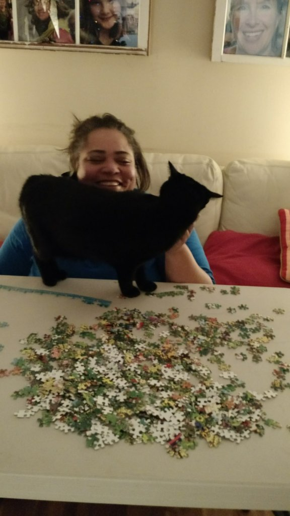 A good puzzle, a good friend, and a friendly cat...cattentment.