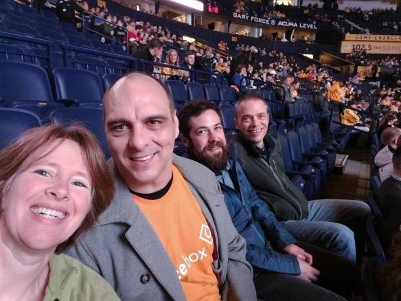 A hockey date night with Buds and his co-workers.