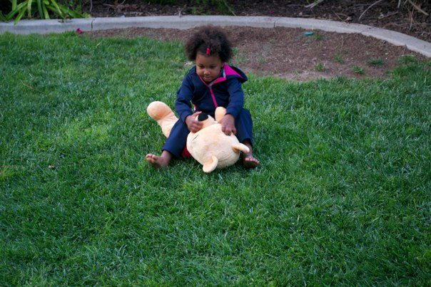 Girl playing with Winnie The Pooh