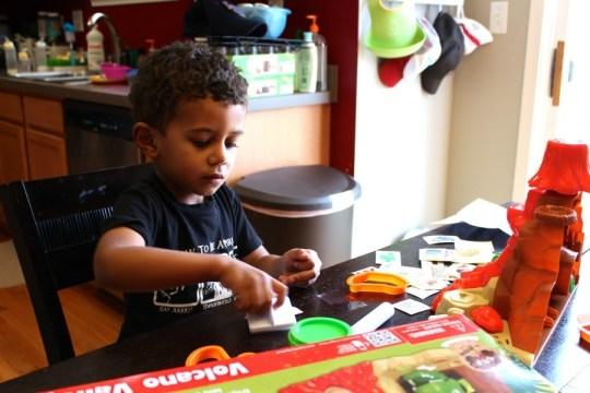 Kid playing with RoseArt's Magic Fun Dough
