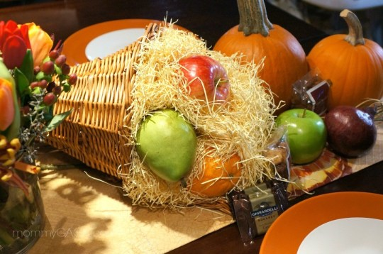 Thanksgiving cornucopia table centerpiece with real fruit
